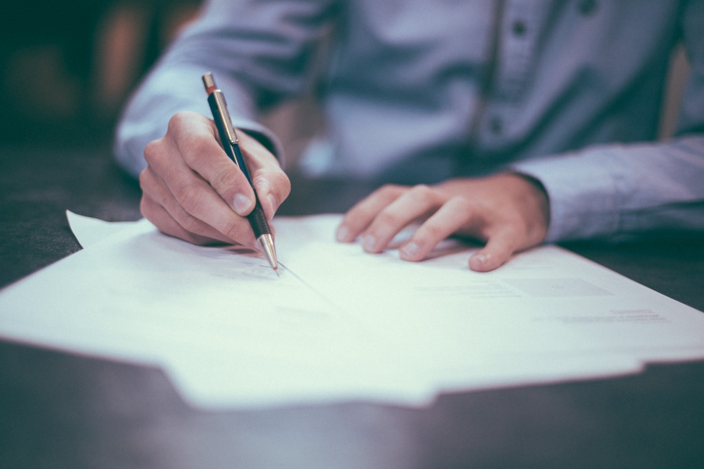 Writing a service contract. Image by http://informedmag.com/